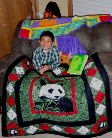 Omar and his new Panda Quilt